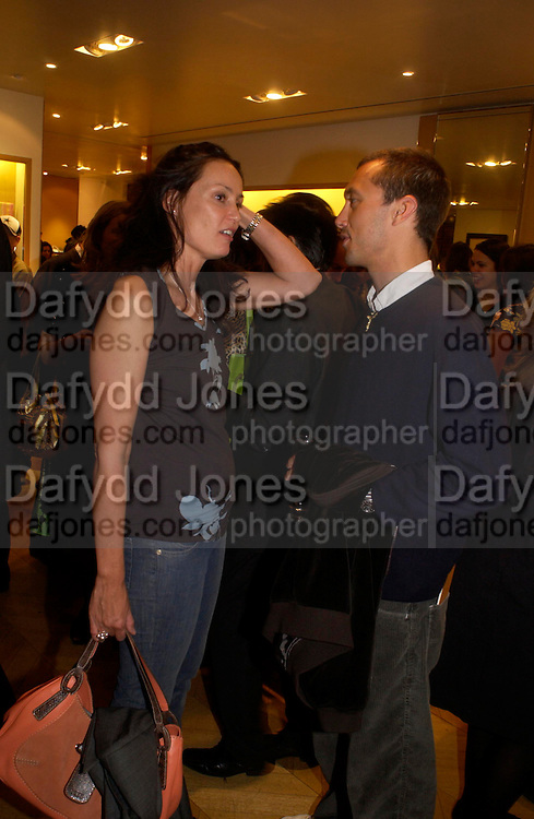 Trisha Simonon and Dan Macmillan.  Tod's hosts Book signing with Dante Ferretti celebrating the launch of 'Ferretti,- The art of production design' by Dante Ferretti. tod's, Old Bond St. 19 April 2005.  ONE TIME USE ONLY - DO NOT ARCHIVE  © Copyright Photograph by Dafydd Jones 66 Stockwell Park Rd. London SW9 0DA Tel 020 7733 0108 www.dafjones.com
