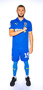 AFC Wimbledon attacker Shane McLoughlin (19)  during the official team photocall for AFC Wimbledon at the Cherry Red Records Stadium, Kingston, England on 8 August 2019.