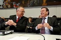 17 DEC 2002, BERLIN/GERMANY:<br /> Hans Eichel (L), SPD, Bundesfinanzminister, und Gerhard Schroeder (R), SPD, Bundeskanzler, im Gespraech, vor Beginn der Sitzung der SPD Bundestagsfraktion, Deutscher Bundestag<br /> IMAGE: 20021217-01-026<br /> KEYWORDS: Fraktionssitzung, Gerhard Schröder,  Gespäch, freundlich, lachen, lacht