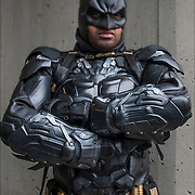Cosplay attendee in his costume, as Batman.<br /> <br /> Cosplay, a contraction of the words costume play, is a performance art in which participants called cosplayers wear costumes and fashion accessories to represent a specific character.<br /> <br /> Cosplayers often interact to create a subculture and a broader use of the term &quot;cosplay&quot; applies to any costumed role-playing in venues apart from the stage. Any entity that lends itself to dramatic interpretation may be taken up as a subject and it is not unusual to see genders switched. Favorite sources include manga and anime, comic books and cartoons, video games, and live-action films and television series.<br /> <br /> The New York Comic Con convention, is a celebration of comic books, graphic novels, sci-fi and video games, toys, movies and television.