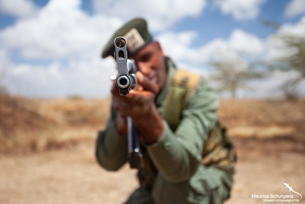 A ranger takes aim with his AK47