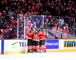 Team Canada at the opening game of the 2015 World Junior Championships in Montreal, Quebec on Friday Dec. 26, 2014. Canada defeated Slovakia 8-0. Photo by Aaron Bell/CHL Images.