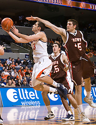 Virginia guard Sammy Zeglinski (13) drives past Brown forward Matt Mullery (45) for a layup.  The Virginia Cavaliers defeated the Brown University Bears 74-50 in NCAA Basketball at the John Paul Jones Arena on the Grounds of the University of Virginia in Charlottesville, VA on January 6, 2009.
