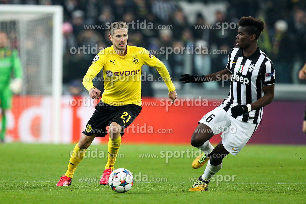 24.02.2015, Veltins Arena, Turin, ITA, UEFA CL, Juventus Turin vs Borussia Dortmund, Achtelfinale, Hinspiel, im Bild l-r: im Zweikampf, Aktion, mit Oliver Kirch #21 (Borussia Dortmund) und Paul Pogba #6 (Juventus Turin) // during the UEFA Champions League Round of 16, 1st Leg match between between Juventus Turin and Borussia Dortmund at the Veltins Arena in Turin, Italy on 2015/02/24. EXPA Pictures &copy; 2015, PhotoCredit: EXPA/ Eibner-Pressefoto/ Kolbert<br /> <br /> *****ATTENTION - OUT of GER*****