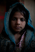 A portrait of Shumila Oad, age 6, enslaved with her whole family and lived in Azadnagar since 2005.<br /> <br /> Following the release of the Global Slavery Index by the Walk Free Foundation Pakistan is ranked 3rd worse in the world behind India and China. The Asian Development Bank estimates some 1.8 million people are slaves in Pakistan yet other estimates reach up to 4 million people, most of which toil year after year in brick kilns or sugar cane plantations. Their stories are the same; they have no-where to turn so they borrow money from a land-owner for a medical emergency or marriage dowry. The landlords pay in return for work, their labour supposed to be taken off the amount borrowed. Yet after years of no salary incredibly their amount owed is often quadrupled, the excuse being the amount they cost to feed! Many are chained, abused, raped and even killed.<br /> <br /> For years they had no where to run, no one to help but now a small local NGO called the Green Development Rural Organisation (GDRO) works to free bonded-slaves by using the law against their captives. Yet, often freed slaves end up right back where they were or risk being hunted by the landowner and forced to return. So GRDO started building villages so slaves who escape or are freed have somewhere safe to go. It now has two, whose names translate from Urdu as 'Village of the Freed' and 'Village of the Courageous', and is working on a 3rd. The land is bought and allocated to freed slave families where they can built a house and start again. Without such help the vicious cycle would continue.