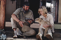 Bill Travers (1922 - 1974) and Virginia McKenna play George and Joy Adamson in the Columbia picture 'Born Free', 1966. Here they feed a lion cub from a bottle.