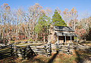 In Cades Cove, John Oliver Cabin was built circa 1822, making it one of the oldest structures in Great Smoky Mountains National Park, USA. Oliver fit the log corners with half dovetail notches draining outwards to discourage rot. The cabin roof was fitted with 3,000 handmade shakes (wooden shingles). Cades Cove, once home to numerous settlers, is an isolated valley located in the East Tennessee section of Great Smoky Mountains National Park, USA. Today Cades Cove is the most popular destination for visitors to the park, attracting over two million visitors a year, due to its well preserved homesteads, scenic mountain views, and abundant display of wildlife.