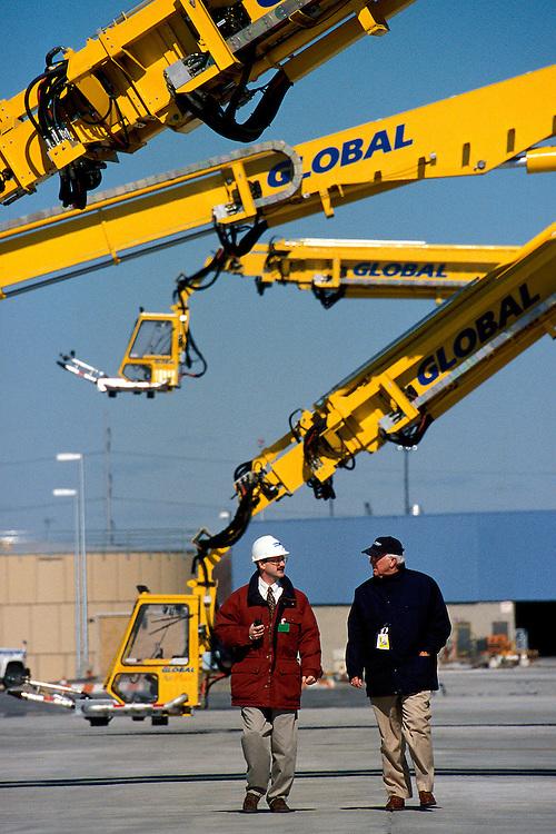 Executives confer at a de-icing facility for commercial aircraft
