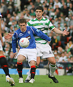 Rangers' Steven Davis shields the ball from Celtic's Darren O'Dea during the League Cup final between Rangers and Celtic at Hampden Park -<br /> David Young Universal News And Sport