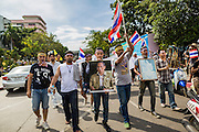 30 NOVEMBER 2013 - BANGKOK, THAILAND:  Anti-government students from Ramkhamhaeng University in Bangkok march down a Bangkok street Satuday. Political faultlines in Bangkok, the Thai capital, hardened Saturday. Antigovernment factions repeated promises to strike at the heart of Bangkok Sunday and bring down the government while thousands of Red Shirts, who support the government, have come to Bangkok from their base in rural Thailand to defend the government. Prime Minister Yingluck Shinawatra has appealed for calm, but her opponents have rejected all requests for negotiations saying the only acceptable outcome is the eradication of the government.       PHOTO BY JACK KURTZ