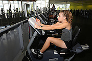 Freshman math major, Taylor Corcoran, studies for one hour a day while she works out on the reclining bicycle at the Student Recreation Center, University of Arizona, Tucson, Arizona, USA.