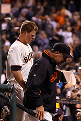 SAN FRANCISCO, CA - JUNE 13: Matt Cain #18 of the San Francisco Giants (left) and manager Bruce Bochy #15 (right) return to the dugout after the game against the Houston Astros at AT&T Park on June 13, 2012 in San Francisco, California. Cain pitched a perfect game as the San Francisco Giants defeated the Houston Astros 10-0. (Photo by Jason O. Watson/Getty Images) *** Local Caption *** Matt Cain; Bruce Bochy