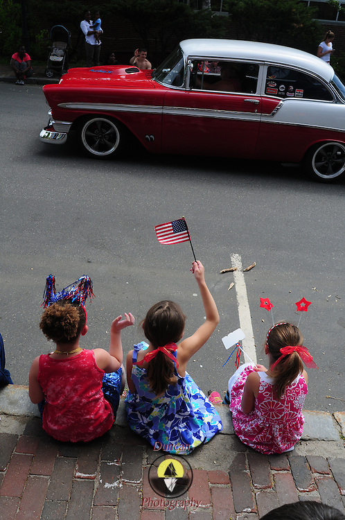 BATH -- 5/25/15 - From left, Hazel Bachman, 7, and her friends, Avery and Harper, wave at a cool old car at the beginning of the Memorial Day Parade in Bath. <br /> The parade took place as a result of an anonymous donor who gave $5,000 and the American Legion who donated $3,000 to pay for the parade in Bath. The Elks Club supported the parade in prior years but was unable to do so this year, leaving organizers without a funding source close to the parade date.  <br /> Photo ©2015 by Roger S. Duncan / For the Forecaster.
