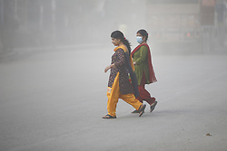 September 7, 2016 - Kathmandu, Nepal - Nepalese women get across a polluted road caused by heavy vehicles in Kalanki, Kathmandu, Nepal on Wednesday, September 7, 2016. Nepal ranks 177 among 180 countries in terms of air quality with pollution index of 81.76. (Credit Image: © Skanda Gautam via ZUMA Wire)