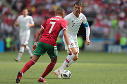 June 20, 2018 - Moscow, U.S. - MOSCOW, RUSSIA - JUNE 20: forward Cristiano Ronaldo of Portugal and midfielder Hakim Ziyach of Morocco during a Group B 2018 FIFA World Cup soccer match between Portugal and Morocco on June 20, 2018, at Luzhniki Stadium in Moscow, Russia. (Photo by Anatoliy Medved/Icon Sportswire) (Credit Image: © Anatoliy Medved/Icon SMI via ZUMA Press)