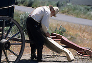 Man, working, Covered Wagon, Wagon, Baker City, Oregon