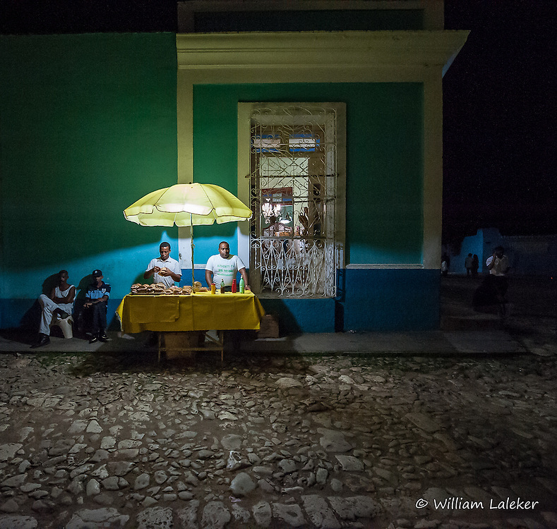 Late night street food in the Plaza Mayor near the Iglesia Parroquial de la Santisima in Trinidad, Cuba