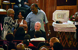 07 September 2013. New Hope Baptist Church. New Orleans, Louisiana. <br /> Mayor Mitch Landrieu  comforts the victim's family when he attends the funeral service for 1 year old toddler Londyn Unique Reed Samuels, shot to death August 29th.  The infant Londyn was shot by thugs whilst in the arms of her babysitter, the intended victim who was holding Londyn whilst walking down the street at the time of the assault. NOPD has arrested 2 men in connection with the heinous crime.<br /> Photo; Charlie Varley