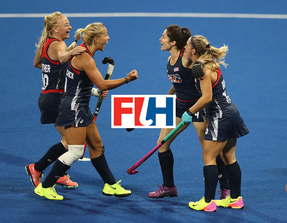 RIO DE JANEIRO, BRAZIL - AUGUST 13:  Michelle Vittese (2nd R) of the USA celebrates with team mates after scoring a goal during the Women's group B hockey match between Great Britain and the USA on Day 8 of the Rio 2016 Olympic Games at the Olympic Hockey Centre on August 13, 2016 in Rio de Janeiro, Brazil.  (Photo by David Rogers/Getty Images)