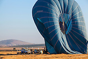 Hot air balloon being deflated. Photographed in the Jezreel Valley, Israel Mount Gilboa in the background