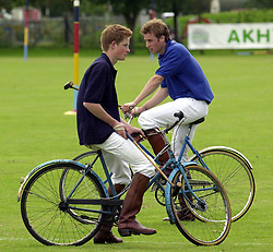 File photo dated 13/7/2002 of Prince Harry on the Eventers team and Prince William on the Jockeys team taking a break whilst playing in the bicycle part of the Jockeys v Eventers Charity polo match at Tidworth Polo Club, Wiltshire.