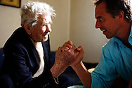 After hearing tales of Kouvaris's strength, Dan Buettner challenged him to an arm-wrestling match. Kouvaris prevailed over a man less than half his age.