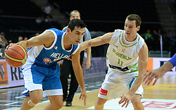 Nikalaos Zisis of Greece vs Goran Dragic of Slovenia during friendly match between National Teams of Slovenia and Greece before World Championship Spain 2014 on August 17, 2014 in Kaunas, Lithuania. Photo by Robertas Dackus / Sportida.com