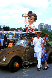 Stock photo of a woman and girl with a classic drive-in car