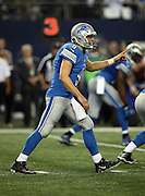 Detroit Lions quarterback Matthew Stafford (9) points toward the defense as he calls a play from the shotgun formation during the NFL week 18 NFC Wild Card postseason football game against the Dallas Cowboys on Sunday, Jan. 4, 2015 in Arlington, Texas. The Cowboys won the game 24-20. ©Paul Anthony Spinelli