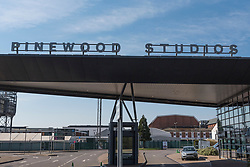 © Licensed to London News Pictures. 26/03/2020. IVER, UK.  A general view of the entrance to Pinewood Studios in Iver, Buckinghamshire, just outside London, home to James Bond 007, Marvel and Star Wars films.  Work on productions has all but ceased due to the coronavirus pandemic.  Workers in the industry comprise mainly the self-employed (from cameramen to background artistes) and later today Rishi Sunak, Chancellor of the Exchequer, is due to launch a financial support plan for them and members of the self employed in other industries.  Photo credit: Stephen Chung/LNP