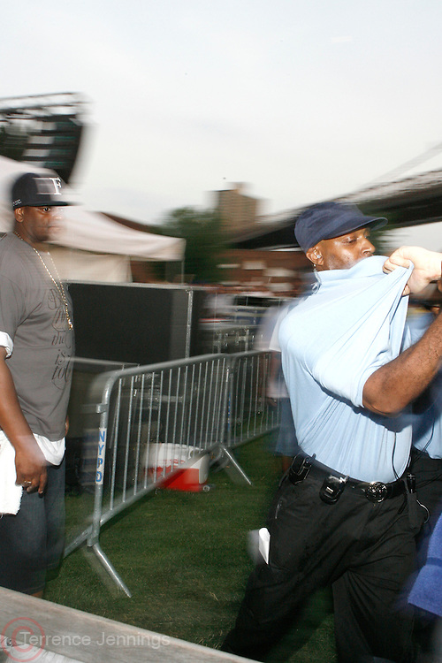 Audience member being ejected at The 4th Annual Brooklyn HipHop Festival Main performance sponsored by Truth held at Empire Fulton-Ferry State Park on July 12, 2008..The Kings and Queens of Brooklyn return home supported by the next wave from Brooklyn and beyond featuring performances from: KRS One, DJ Premier, Buckshot, Blu & Exile, Mickey Factz, 88-Keys, J.Period, Fresh Daily, Zaki Ibrahim, Homeboy Sandman and Special Guests! Hosted by Uncle Ralph McDaniels ..