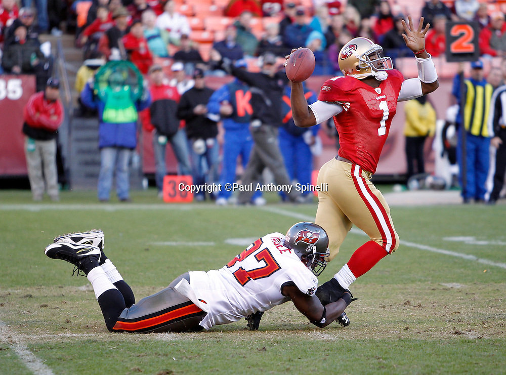 San Francisco 49ers quarterback Troy Smith (1) gets sacked by Tampa Bay Buccaneers defensive end Alex Magee (97) during the NFL week 11 football game against the Tampa Bay Buccaneers on Sunday, November 21, 2010 in San Francisco, California. The Bucs won the game 21-0. (©Paul Anthony Spinelli)