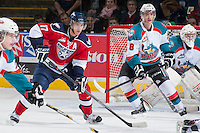 KELOWNA, CANADA - MARCH 23: Philip Tot #17 of the Tri-City Americans looks for the pass while Joe Gatenby #28 of the Kelowna Rockets blocks the net on March 23, 2014 at Prospera Place in Kelowna, British Columbia, Canada.   (Photo by Marissa Baecker/Shoot the Breeze)  *** Local Caption *** Philip Tot; Joe Gatenby;