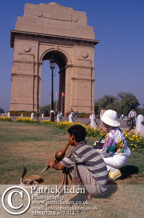 snake charmer, tourist, India Gate, New Delhi, India photograph photography