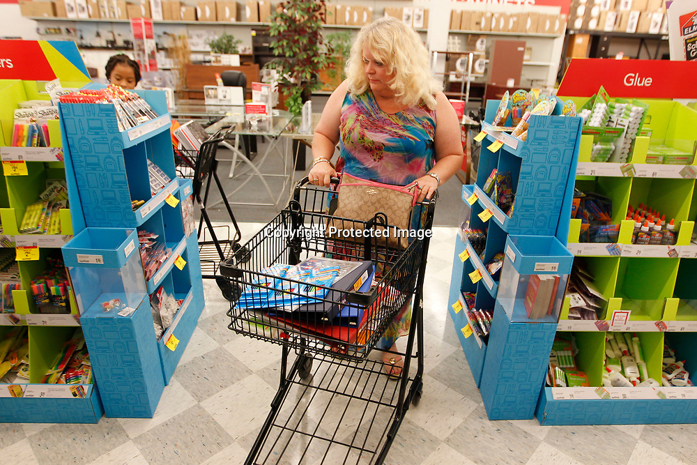 Connie Gusmus, a seventh grade science teacher at Guntown Middle School, shops for basic school suplies for her classroom at OfficeMax in Tupelo.