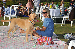 LISA CARTER and Shimmer the dog at a cricket match to in aid of CARE - Corfu Animal Rescue Establishment held at Hawkley Cricket Club, Hawkley, Hampshire on 8th September 2012.
