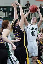 12 December 2015:  Ashley Schneider shoots over Joann Wolfenberg during an NCAA women's basketball game between the Wisconsin Stevens Point Pointers and the Illinois Wesleyan Titans in Shirk Center, Bloomington IL