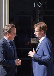 © Licensed to London News Pictures. 08/07/2013. London, UK. Fresh from yesterday's win on Centre Court at Wimbledon British champion Andrew Murray meets the British Prime Minister David Cameron on Downing Street in London today (08/07/2013). Photo credit: Matt Cetti-Roberts/LNP
