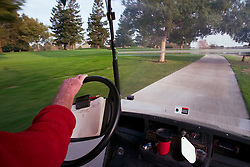 Riding in golf cart at Stanford Golf Course.