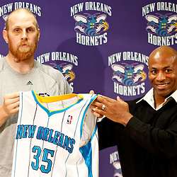 December 17, 2011; New Orleans, LA, USA; New Orleans Hornets center Chris Kaman (35) and general manager Dell Demps at a press conference to introduce players acquired from the Los Angeles Clippers in the Chris Paul trade prior to team scrimmage at the New Orleans Arena.   Mandatory Credit: Derick E. Hingle-US PRESSWIRE