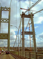 Third Tacoma Narrows Bridge construction work - ready for installation of the road deck sections while traffic passes on the nearby second Tacoma Narrows Bridge (the new bridge will carry eastbound traffic on Washington State Route 16 from the Kitsap Peninsula across the Tacoma Narrows, a part of Puget Sound, Tacoma, Washington, USA (July 2006) (The first bridge at this location was nicknamed Galloping Gertie and was destroyed by wind due to a flaw in its design in 1940 soon after construction was complete. The second bridge, nicknamed Sturdy Gertie was opened in 1950.) The third Tacoma Narrows bridge was opened for traffic in July of 2007.