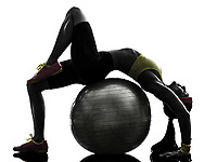 one supple woman exercising fitness workout on fitness ball in silhouette on white background