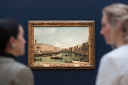 "© Licensed to London News Pictures. 01/12/2017. London, UK.  Staff members view ""The Grand Canal, looking north from near the Rialto Bridge"", 1738, by Bernardo Bellotto, (Est.  GBP2.0-3.0m).  Preview of ""Masters of Light"", Sotheby's Old Masters Evening Sale which will take place on 6 December at Sotheby's, New Bond Street. Photo credit: Stephen Chung/LNP"