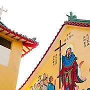 The Chinese style roof and bas relief murals of the Catholic church in Yanshui Village, Tainan County, Taiwan