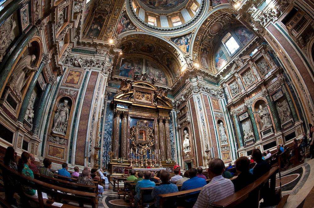 Catholics attend Mass inside a chapel inside St. Mary Major Basilica in Rome. (Sam Lucero photo)