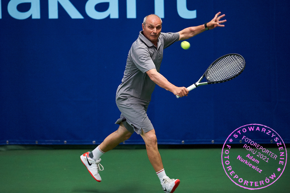 Helsinki, Finland - 2016 June 23: Viktor Zhvanko from Russia in action while team men's Austria Cup (Men 55) match between Germany and Russia during 2016 ITF Seniors World Team Championships at Talin Tenniskeskus on June 23, 2016 in Helsinki, Finland.<br /> <br /> Adam Nurkiewicz declares that he has no rights to the image of people at the photographs of his authorship.<br /> <br /> Picture also available in RAW (NEF) or TIFF format on special request.<br /> <br /> Any editorial, commercial or promotional use requires written permission from the author of image.<br /> <br /> Mandatory credit:<br /> Photo by &copy; Adam Nurkiewicz