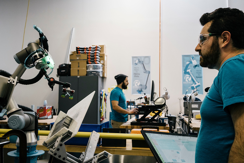 Kel Guerin, right, CTO at Ready Robotics, shows what their robots can be programmed to do at their facility in Baltimore on March 16, 2017. CREDIT: Greg Kahn / GRAIN for the Wall Street Journal ROBOTGAP