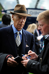 Sir Henry Cecil, 10-time champion trainer, has died at the age of 70.<br /> Responsible for 25 British Classic winners, Cecil was also the leading handler at Royal Ascot with a record 75 successes.<br /> ASCOT  20/10/12<br /> THE QIPCO CHAMPION STAKES.<br /> Trainer SIR HENRY CECIL signs autographs after the race.<br /> Photo by: Racingfotos.com / i-Images.