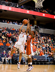 Virginia forward Lyndra Littles (1) shoots over Clemson forward D'Lesha Lloyd (23).  The Virginia Cavaliers women's basketball team defeated the Clemson Tigers 83-71 at the John Paul Jones Arena in Charlottesville, VA on February 21, 2008.
