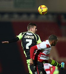 Yeovil Town's Kevin Dawson wins an aerial duel with Doncaster Rovers' Reece Wabara - Photo mandatory by-line: Matt Bunn/JMP - Tel: Mobile: 07966 386802 22/11/2013 - SPORT - Football - Doncaster - Keepmoat Stadium - Doncaster Rovers v Yeovil Town - Sky Bet Championship
